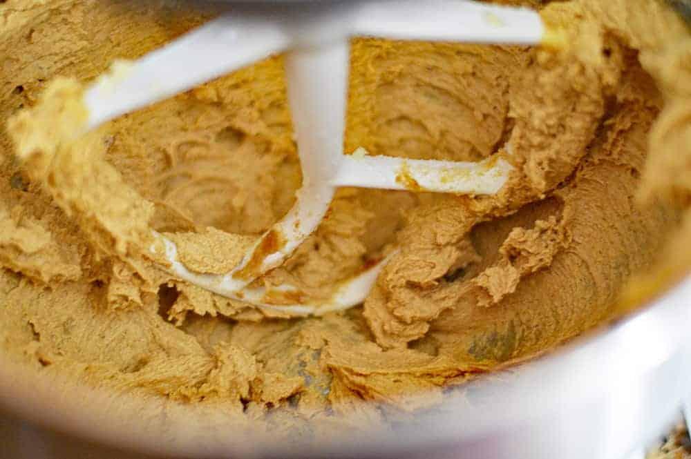Batter in mixing bowl for Big & Chewy Vegan Oatmeal Raisin Cookies