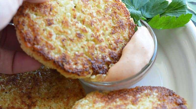 Dipping cauliflower fritter in to Copycat Outback Bloomin' Onion Sauce