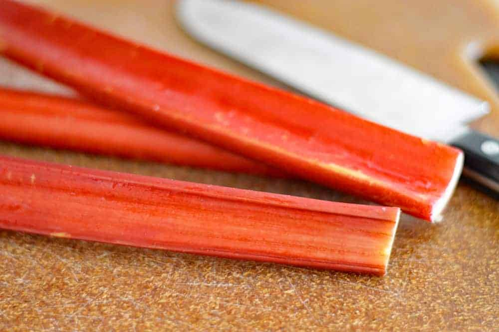 Fresh rhubarb stalks on a cutting board