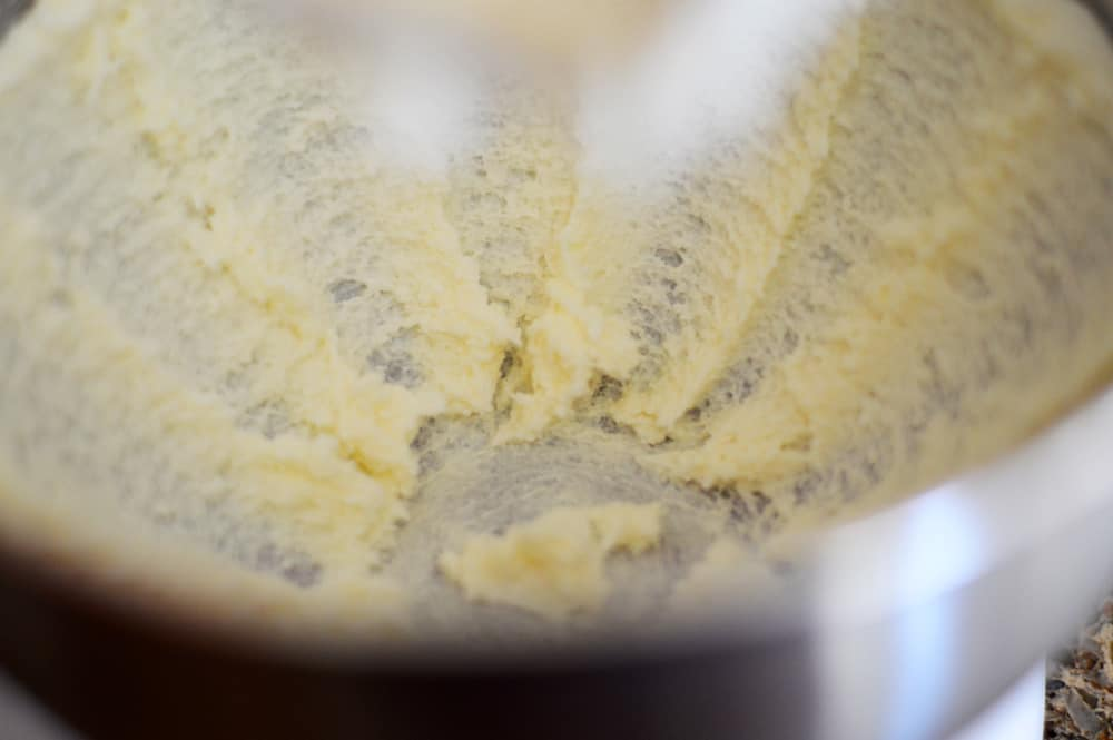 Creaming together butter and sugar in a stainless mixing bowl
