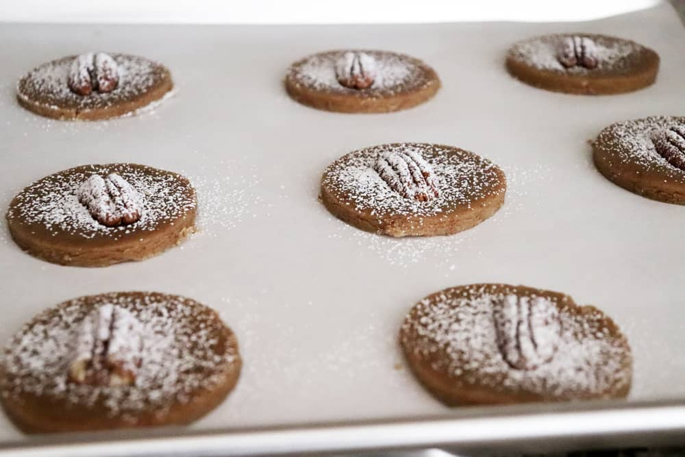 Dusted pecan sandies ready to bake on a cookie sheet