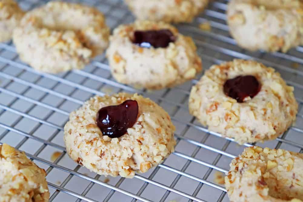 Close up of Jam Filled Vegan Thumbprint Cookies on cooling rack