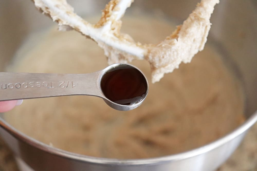 Vanilla extract being added to the electric mixer