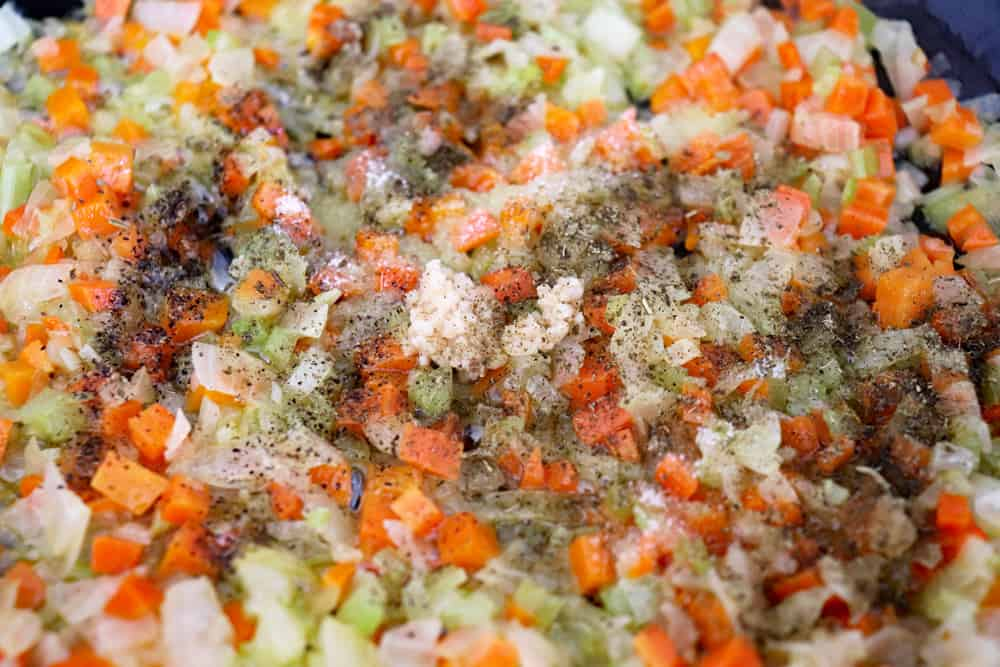 Adding seasonings to the sauteeing vegetables