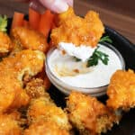 Dipping buffalo cauliflower into ranch dip