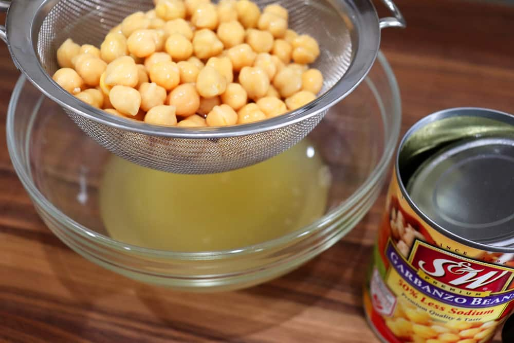 Draining a can of chickpeas
