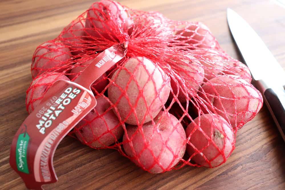 Bag of baby red potatoes for Warm Potato Salad with Dijon Vinaigrette