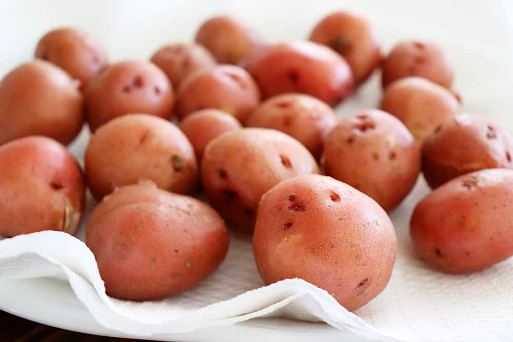 Drying the red potatoes on paper towels for the Warm Potato Salad with Dijon Vinaigrette