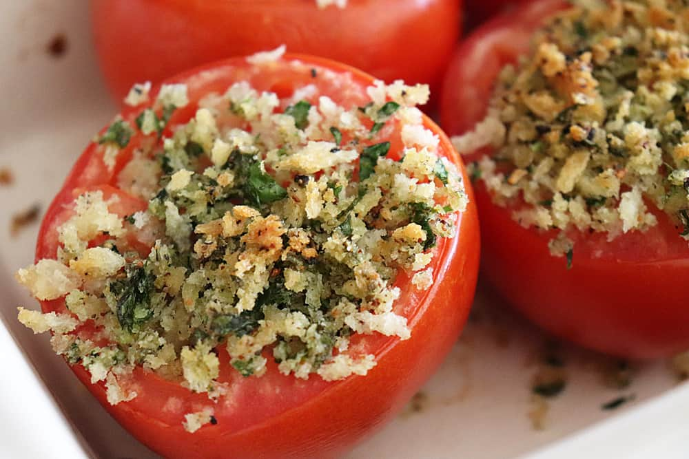 Close up of baked stuffed tomatoes