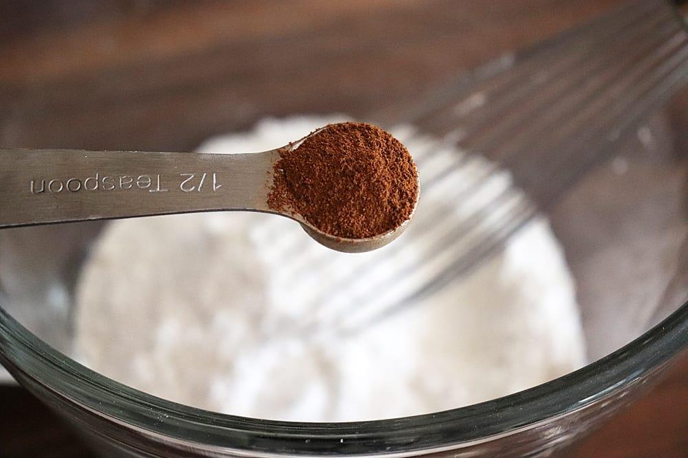 Adding cinnamon to the flour mixture