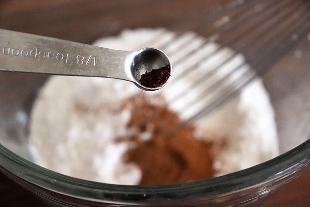 Adding cloves to the flour mixture