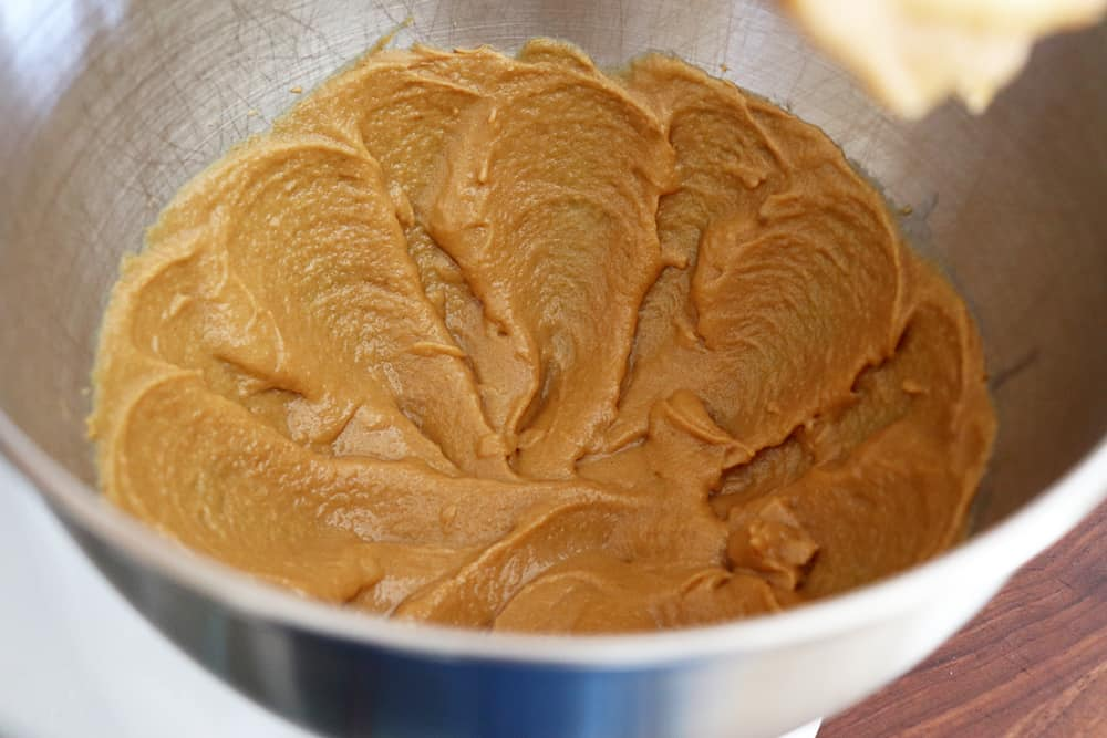 Creaming the peanut butter in a stainless steel mixing bowl