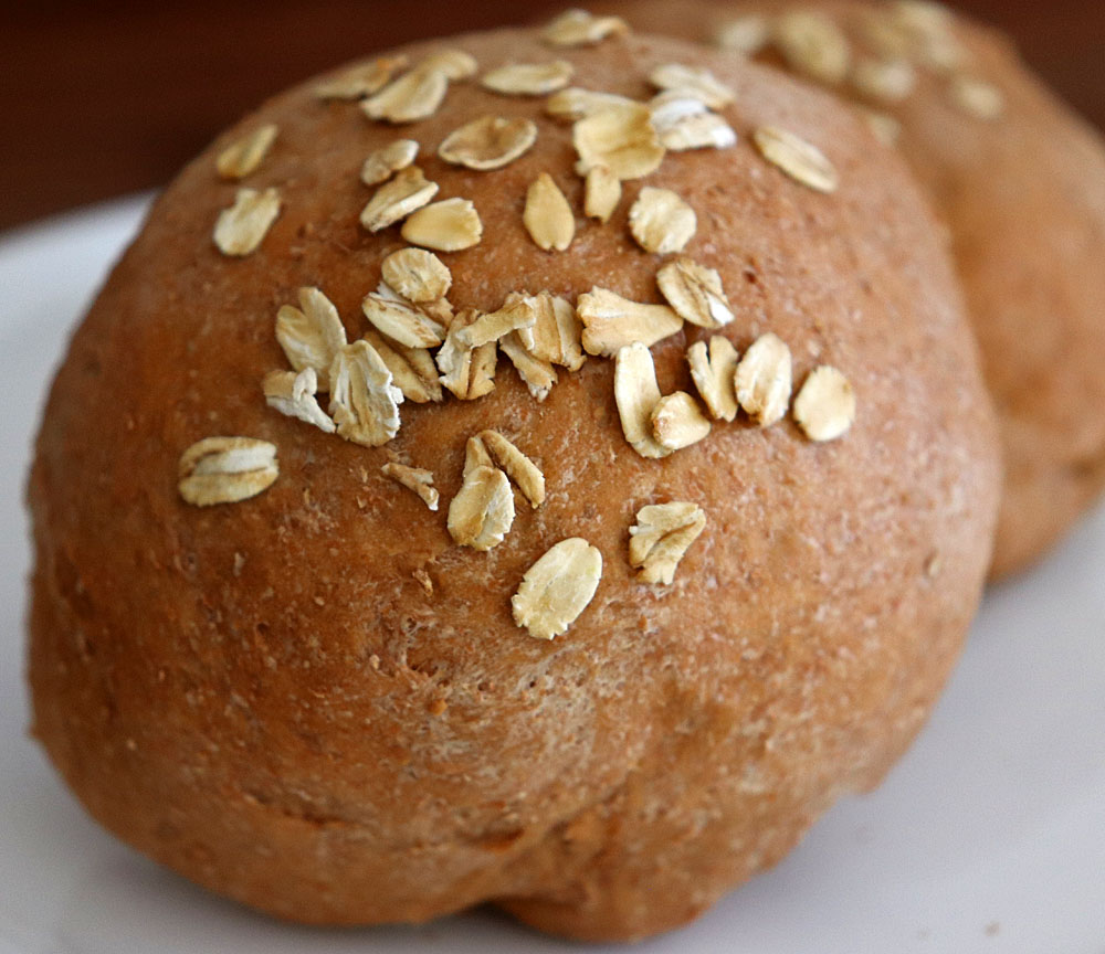 Baked rolls with oats on top